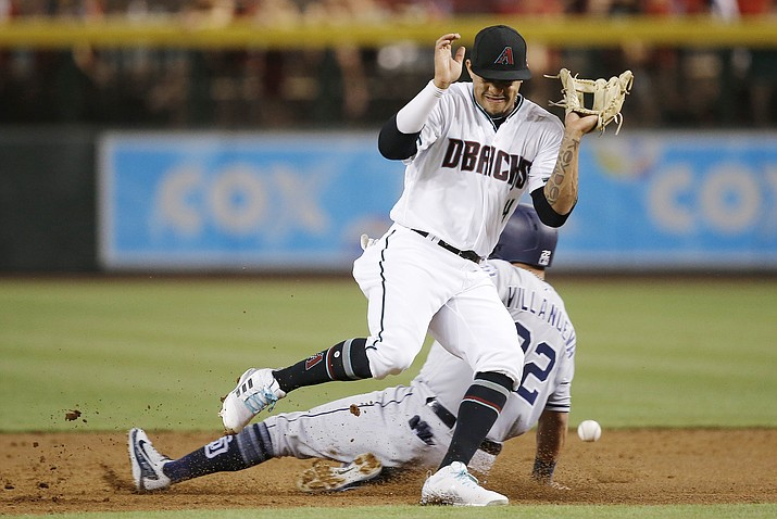 Arizona Diamondbacks shortstop Ketel Marte, front, cannot find the baseball as San Diego Padres' Christian Villanueva steals second base during the first inning of a baseball game Friday, July 6, 2018, in Phoenix. (Ross D. Franklin/AP)