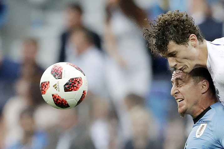 France's Benjamin Pavard, top, and Uruguay's Cristian Rodriguez challenge for the ball during the quarterfinal match between Uruguay and France at the 2018 soccer World Cup in the Nizhny Novgorod Stadium, in Nizhny Novgorod, Russia, Friday, July 6, 2018. (Petr David Josek/AP)
