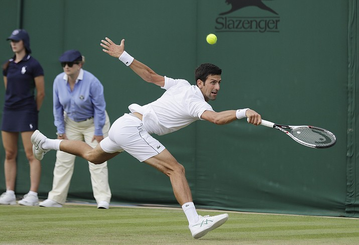 Novak Djokovic of Serbia returns the ball to Horacio Zeballos of Argentina during their men's singles match on the fourth day at the Wimbledon Tennis Championships in London, Thursday July 5, 2018. (Ben Curtis/AP)