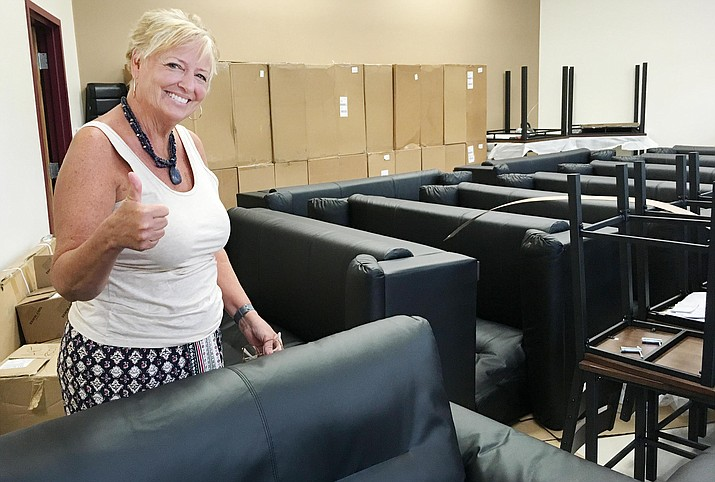 Beaver Creek School District Superintendent Karin Ward celebrates the arrival of new furniture for the school's Blended Learning classrooms. VVN/Bill Helm