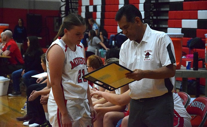 Frank Nevarez coaches forward Summer Scott last season. Nevarez resigned after two seasons as Mingus head girls basketball coach. VVN/James Kelley