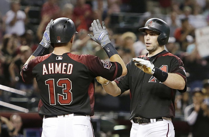 Arizona Diamondbacks' Paul Goldschmidt celebrates with Nick Ahmed (13) after hitting a three-run home run against the San Diego Padres in the fourth inning during a baseball game, Saturday, July 7, 2018, in Phoenix. (Rick Scuteri/AP)