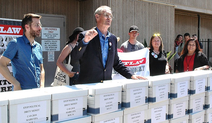 Former Attorney General Terry Goddard explains Thursday how an initiative drive would constitutionally require disclosure the original source of campaign contributions. Backers collected more than 285,000 signatures to put the issue on the November ballot. Capitol Media Services photo by Howard Fischer