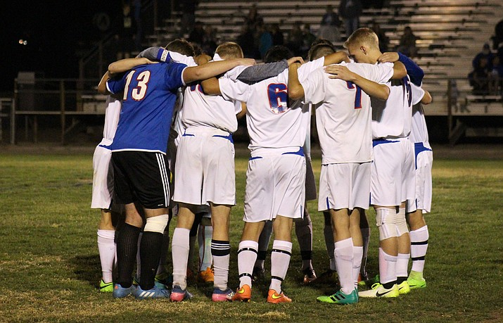 Camp Verde boys soccer players pray before their shootout against Show Low. Camp Verde tied Show Low 1-1 but lost to the Cougars in the penalty kick shootout. VVN/James Kelley