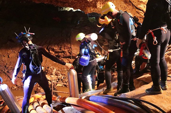Thai rescue team members walk inside a cave where 12 boys and their soccer coach have been trapped since June 23, in Mae Sai, Chiang Rai province, northern Thailand. (Royal Thai Navy)