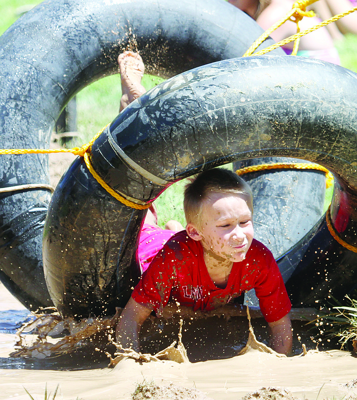 Children run through the Mighty Mud Mania obstacle course at Firefighter's Memorial Park in 2016. This year's event is scheduled for 10 a.m. Thursday. (Daily Miner file photo)