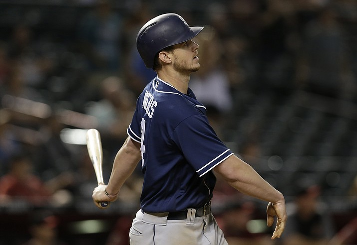 San Diego Padres' Wil Myers hits a solo home run against the Arizona Diamondbacks in the 16th inning during a baseball game, Sunday, July 8, 2018, in Phoenix. (Rick Scuteri/AP Photo)