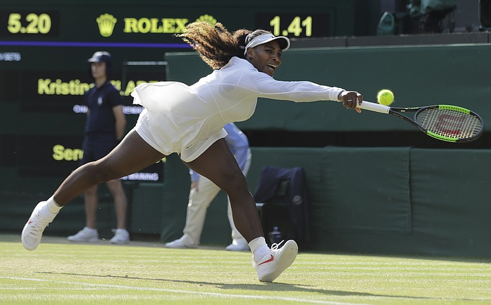 Serena Williams of the United States fails to return the ball to France's Kristina Mladenovic during their women's singles match, on the fifth day of the Wimbledon Tennis Championships in London, Friday July 6, 2018. (Ben Curtis/AP Photo)