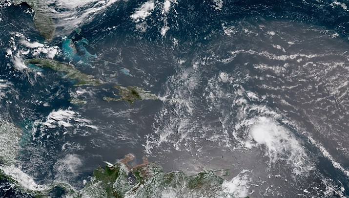 In this geocolor image GOES-16 satellite image taken Sunday, July 8, 2018, at 15:00 UTC, shows Tropical Storm Beryl, center right, moving across the Lesser Antilles in the eastern Caribbean Sea, and Tropical Storm Chris, top left, off the U.S. East Coast. (NOAA)