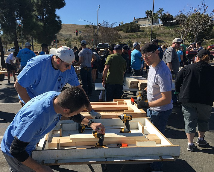 David Wayt (front), Scott Holtry (back left), and numerous volunteers learn the proper way to build beds at Sleep in Heavenly Peace's training held Feb. 24 in San Diego. (Courtesy photo)