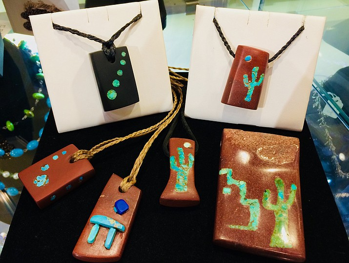 "Cheston Trammel's handcrafted ""Arizona Spirit Bundles"" are adorned with hand-carved  pendants inlaid with turquoise and lapis. Prayers and blessing are woven into each of these pieces. His distinctive and comfortable work is prized and worn by both men and women."