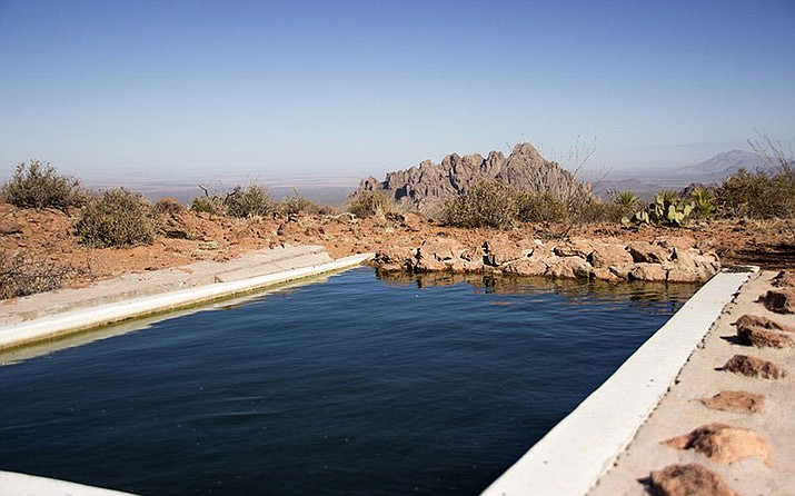 Over the years, the Arizona Desert Bighorn Sheep Society has spent a lot of money and thousands of hours building and re-developing waters in the desert, like the one shown. (Gabriel Sandler/Cronkite News)