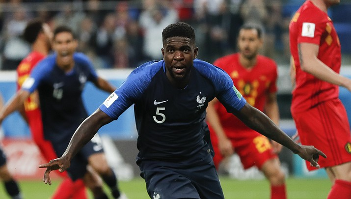 France's Samuel Umtiti celebrates after scoring his sides 1st goal of the game during the semifinal match between France and Belgium at the 2018 soccer World Cup in the St. Petersburg Stadium in, St. Petersburg, Russia, Tuesday, July 10, 2018. (Natacha Pisarenko/AP Photo)