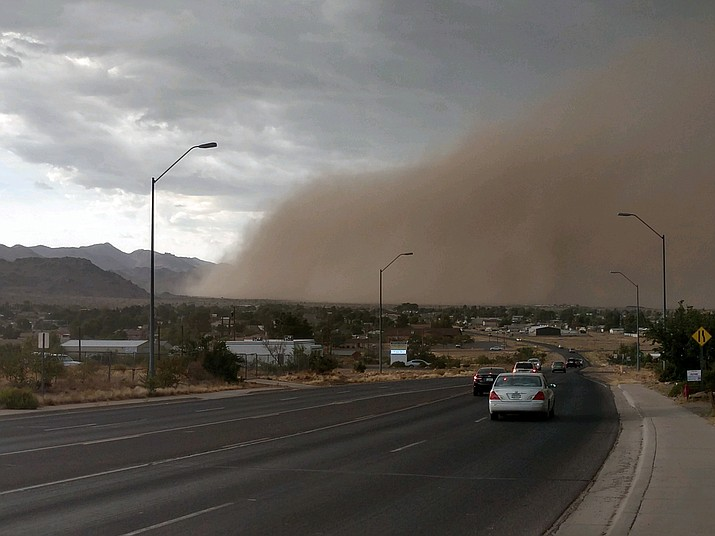 A haboob's giant brown wall contains a lot more than just desert dirt, according to air quality experts. They include manure and pesticides from agricultural land, and dust and tiny spores from beneath the desert crust that can also go airborne, making people sick with Valley fever, which is a fungal lung infection. (Photo by Butch Meriwether/For the Daily Miner)