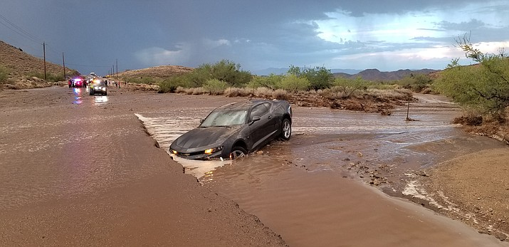 A car got stuck in floodwaters on Stockton Hill Road during Monday's monsoon downpour and the driver was assisted by Mohave County Sheriff's Office Search and Rescue team. (Photo courtesy Mohave County Sheriff's Office)