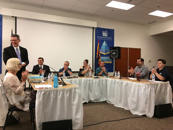 The Governing board of Humboldt Unified School District had many words of praise, applause and tears for Assistant Superintendent James Bogner, standing left, at his final board meeting June 26 before retiring June 30. From left are Finance Director Cynthia Windham, Bogner, Superintendent Dan Streeter, Board President Rich Adler, Vice President Suzie Roth, and board members Paul Ruwald, Ryan Gray and Dr. Dina Battaglia. (Sue Tone/Tribune)