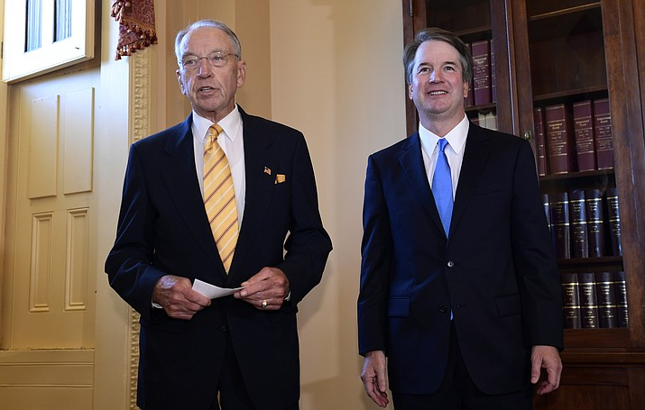 Supreme Court nominee Brett Kavanaugh, right, listens as Sen. Chuck Grassley, R-Iowa, left, speaks on Capitol Hill in Washington, Tuesday, July 10, 2018. (Susan Walsh/AP Photo)