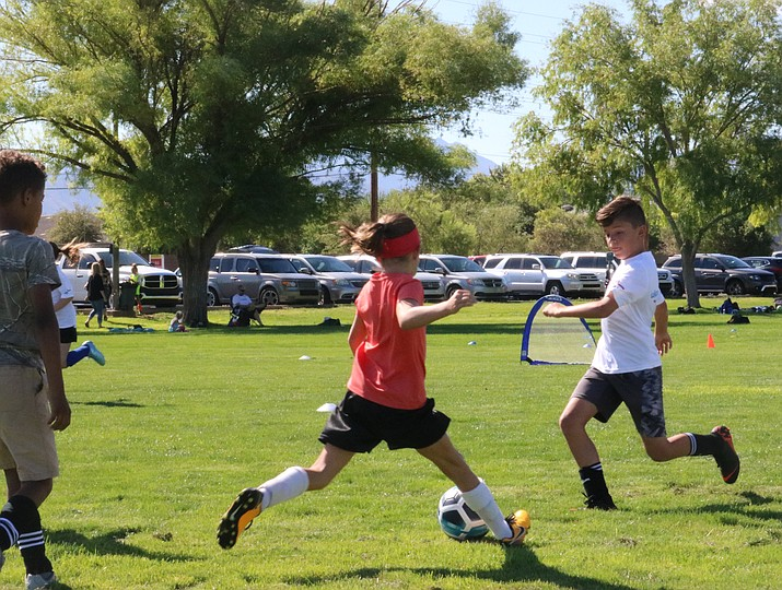 Local soccer players are honing skills and techniques of the game at the UK International Soccer camp running through Friday at Centennial Park. (Travis Rains/Daily Miner)