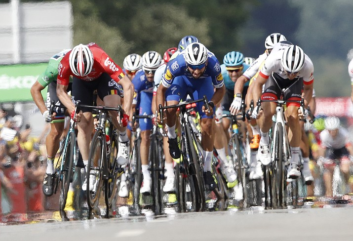 Colombia's Fernando Gaviria, center, sprints to win the fourth stage of the Tour de France cycling race over 195 kilometers (121 miles) with start in La Baule and finish in Sarzeau, France, Tuesday, July 10, 2018. (Christophe Ena/AP Photo)