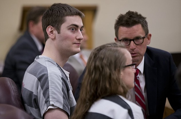 Sarah Elaine Mitchell, right, and Travis Lee Mitchell, the parents of a twin girl who struggled to breath after a home birth, appear in court in Oregon City, Ore., Monday, July 9, 2018. The couple, members of the Followers of Christ Church, that shuns traditional medicine in favor of prayer and anointing the sick with oils, have pleaded guilty to negligent homicide in the death of their premature daughter. (Beth Nakamura/The Oregonian via AP)