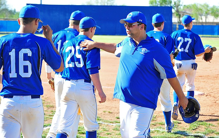Chino Valley head coach Marty Campitelli slaps his players on the back as they take the field Thursday afternoon, April 24, 2014, while playing against Central High School in Chino. (Courier, file)