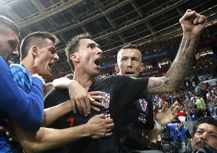 Croatia's Mario Mandzukic, center, celebrates after scoring his side's second goal during the semifinal match between Croatia and England at the 2018 soccer World Cup in the Luzhniki Stadium in Moscow, Russia, Wednesday, July 11, 2018. (Frank Augstein/AP Photo)