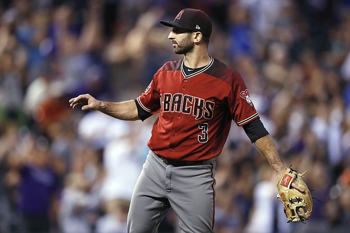 Arizona Diamondbacks infielder-turned-relief-pitcher Daniel Descalso calls for a new ball after giving up a three-run home run to Colorado Rockies' Carlos Gonzalez during the fourth inning of a baseball game Wednesday, July 11, 2018, in Denver. (David Zalubowski/AP Photo)