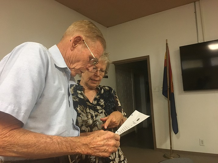 John Bryant, who was appointed Tuesday to fill the remaining vacancy on Northern Arizona Consolidated Fire District's governing board, is handed paperwork by board counsel Charlotte Wells. (Hubble Ray Smith/Daily Miner)