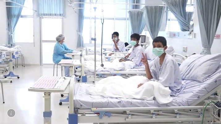 In this image made from video, released by the Thailand Government Spokesman Bureau, three of the 12 boys are seen recovering in their hospital beds after being rescued along with their coach from a flooded cave in Mae Sai, Chiang Rai province, northern Thailand. (Thailand Government Spokesman Bureau)