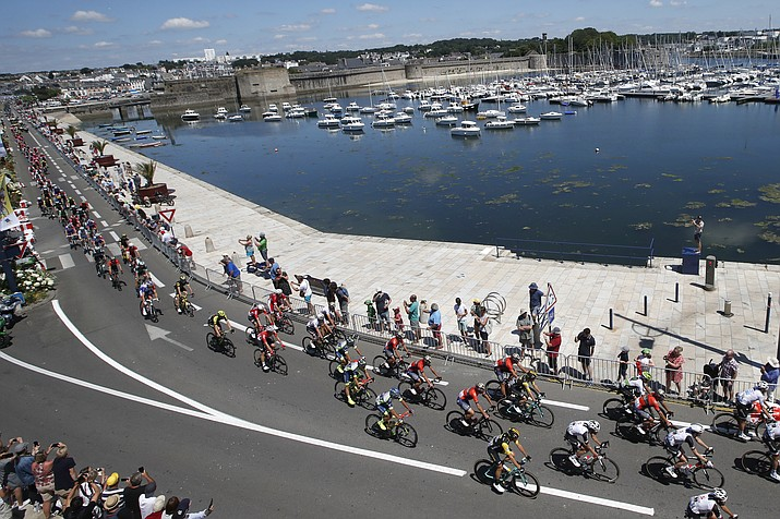 The pack passes through Concarneau during the fifth stage of the Tour de France cycling race over 204.5 kilometers (127 miles) with start in Lorient and finish in Quimper, France, Wednesday, July 11, 2018. (Christophe Ena/AP Photo)