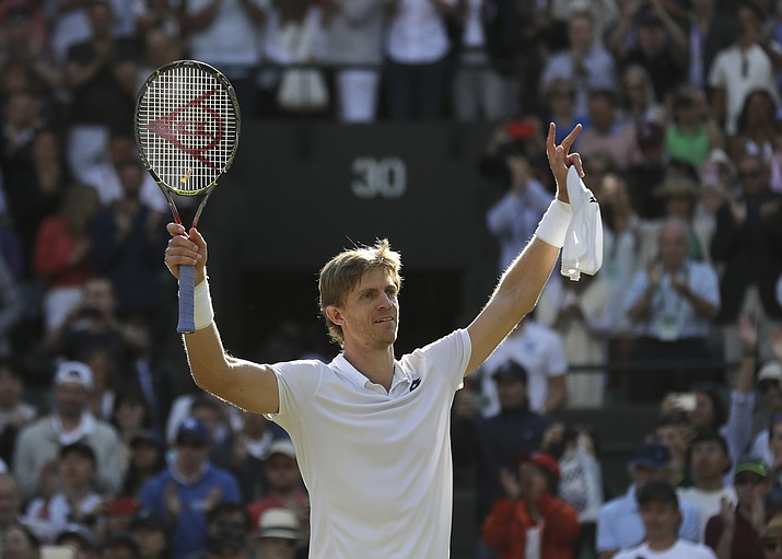 Kevin Anderson of South Africa celebrates winning his men's quarterfinals match against Switzerland's Roger Federer, at the Wimbledon Tennis Championships, in London, Wednesday July 11, 2018. (Ben Curtis/AP Photo)