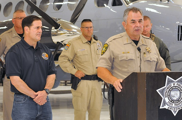With Gov. Ducey looking on, Pima County Sheriff Mark Napier explains Wednesday at a press conference in Phoenix the importance of his agency's partnership with others in law enforcement to deal with border issues. (Howard Fischer/Courtesy)