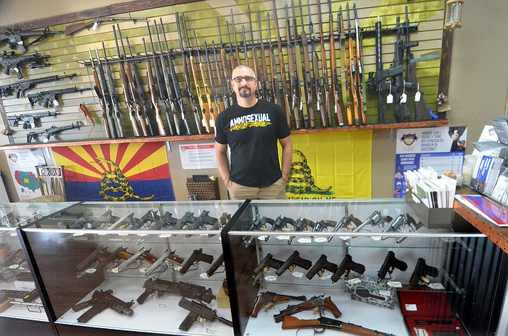 Feral Goat Firearms Owner Robert Wager is behind the counter at his new store in Cottonwood. VVN/Vyto Starinskas