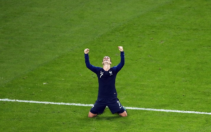 France's Antoine Griezmann celebrates at the end of the semifinal match between France and Belgium at the 2018 soccer World Cup in the St. Petersburg Stadium in St. Petersburg, Russia, Tuesday, July 10, 2018. (Pavel Golovkin/AP Photo)