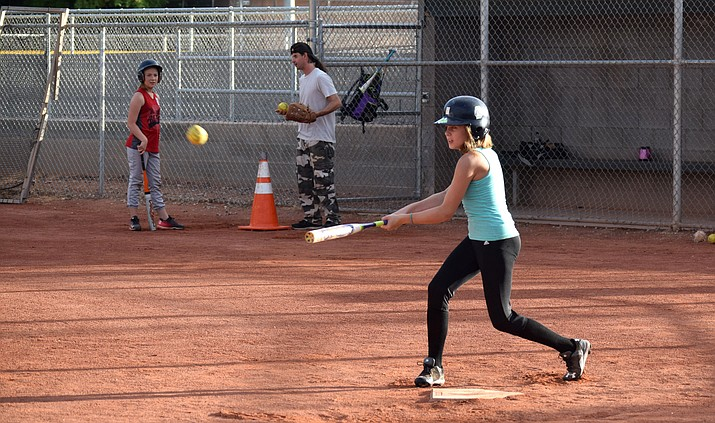 Caitlin Roeller hits the ball during practice on Tuesday at Riverfront Park. Verde Valley Little League's 9-10-11 softball all-star team will compete in the state tournament starting on Friday. VVN/James Kelley