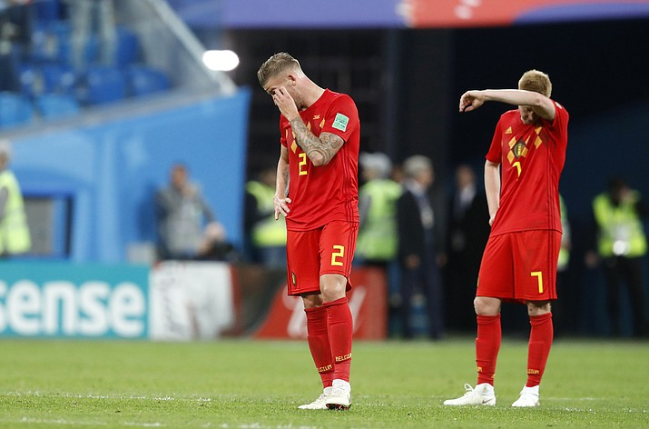 Belgium's Toby Alderweireld, left, and Belgium's Kevin De Bruyne stand on the pitch at the end of the semifinal match between France and Belgium at the 2018 soccer World Cup in the St. Petersburg Stadium, in St. Petersburg, Russia, Tuesday, July 10, 2018. (David Vincent/AP Photo)