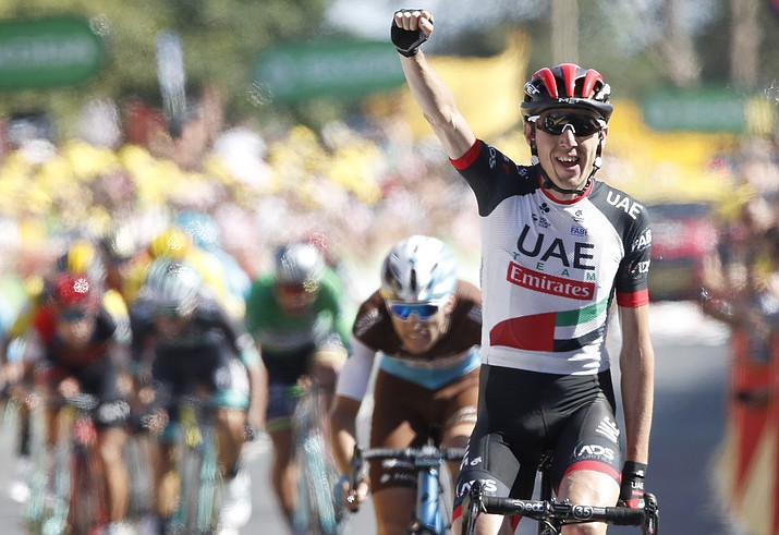 Ireland's Daniel Martin celebrates as he crosses the finish line to win the sixth stage of the Tour de France cycling race over 181 kilometers or 112.5 miles with the start in Brest and finish in Mur-de-Bretagne Guerledan, France, Thursday, July 12, 2018. (Christophe Ena/AP Photo)