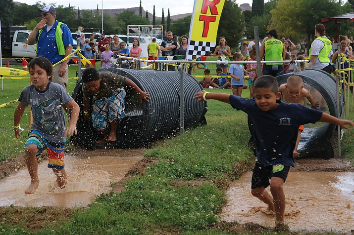 Children getting muddy at the 40th annual Might Mud Mania. (Photo by Travis Rains/Daily Miner)
