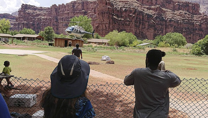 Flash flood sends 200 tourists to high ground near Grand Canyon