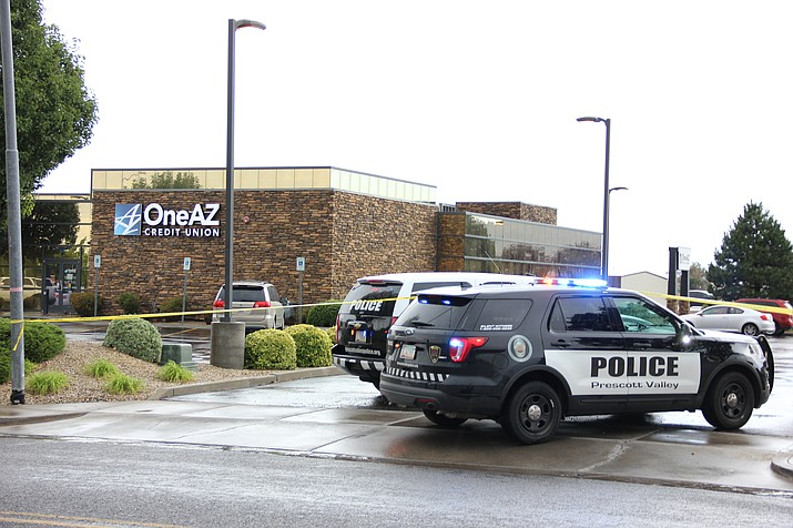 Prescott Valley Police Department officers block off all entrances and exits to the OneAZ Credit Union on Pav Way in Prescott Valley Friday afternoon, July 13, following a report of a robbery at the bank.