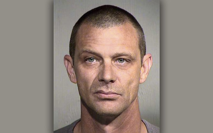 Arizona authorities say Matthew Disbro, a 44-year-old uniformed security guard, is accused of impersonating a police officer by trying to pull over an unmarked car that happened to contain two state troopers patrolling a Phoenix freeway. (Maricopa County Sheriff's Office)