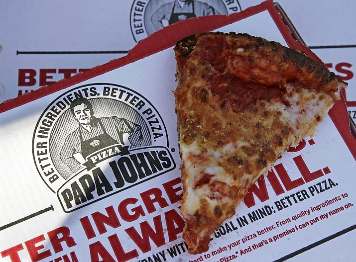 This Dec. 21, 2017, file photo shows a slice of cheese pizza at the Papa John's pizza shop in Quincy, Mass. Papa John's plans to pull Schnatter's image from marketing materials after reports he used a racial slur. Schnatter apologized Wednesday, July 11, and said he would resign as chairman after Forbes reported that he used the slur during a media training session. Schnatter had stepped down as CEO last year after criticizing NFL protests. (AP Photo/Charles Krupa, File)