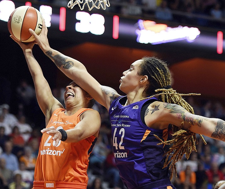 Phoenix Mercury center Brittney Griner (42) blocks the shot of Connecticut Sun guard Layshia Clarendon during the first half of a WNBA basketball game Friday, July 13, 2018. (Sean D. Elliot/The Day via AP)