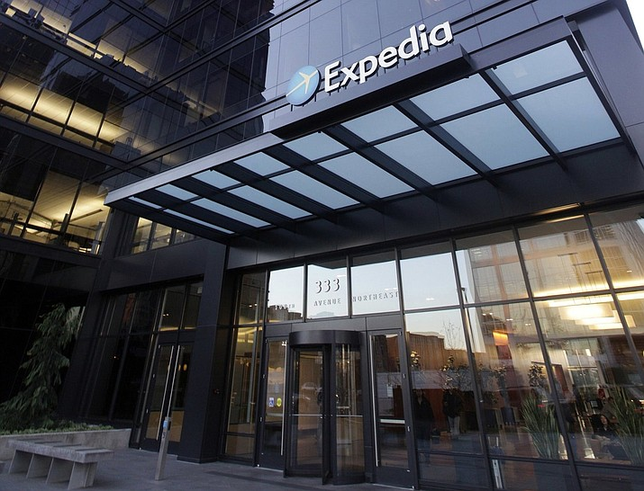 In this Tuesday, Jan. 15, 2013 photo, a building housing Expedia is seen in Bellevue, Wash. After a traveler's flight was canceled, she's still chasing down a refund from the company. (AP Photo/Elaine Thompson, File)