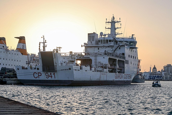 The Diciotti ship of the Italian Coast Guard, with 67 migrants on board rescued 4 days ago by the Vos Thalassa freighter, is moored in the Sicilian port of Trapani, southern Italy, Thursday, July 12, 2018. An Italian coast guard ship has docked in Sicily but is still awaiting permission to disembark its 67 migrants, after two of them were accused of threatening their rescuers if they were taken back to Libya. Interior Minister Matteo Salvini said Thursday he won't let the migrants off until there is clarity over what happened after an Italian commercial tugboat rescued them over the weekend. Italy's transport minister said some migrants made death threats against the crew. The threats prompted the Italian coast guard to board the migrants and bring them to Trapani. (Igor Petyx/ANSA)