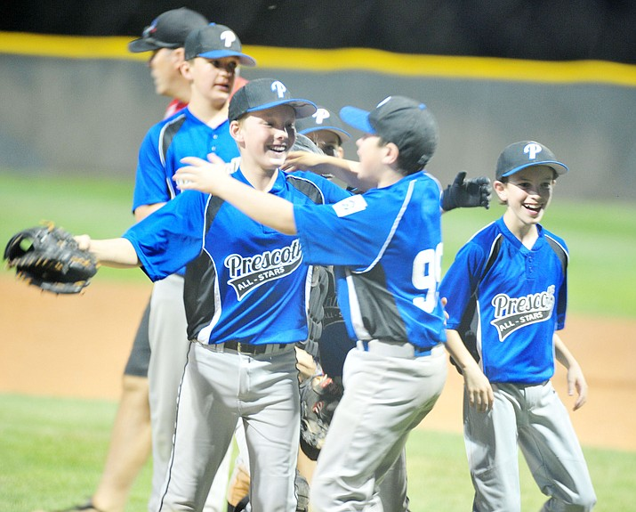 Prescott players celebrate after defeating the Prescott Valley team 13-0 in the Little League D10 Under 11 Championship game at Ziegler Field in Prescott Tuesday, June 26, 2018. (Les Stukenberg/Courier, file)
