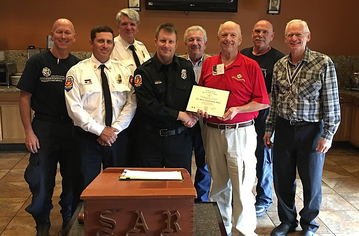 Pictured from left are: Jeff Jones, firefighter; Scott Luedeman, fire battalion chief; Dennis Light, fire chief; Jeremy Sarge, engineer and honoree; Craig Brown, county supervisor, district 4; Tim Prater, SAR Prescott Chapter Awards chairman; Tim Herrington, captain; and Wayne Hood, president of the SAR Prescott Chapter. (Courtesy)