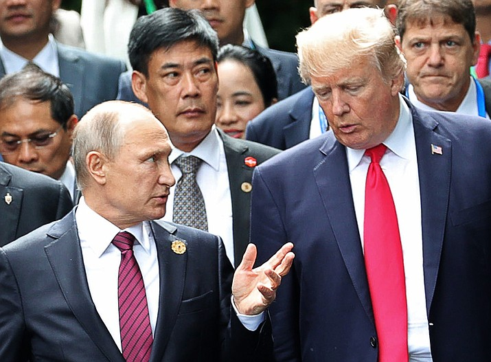 In this Nov. 11, 2017, file photo, U.S. President Donald Trump, right, and Russia's President Vladimir Putin talk during the family photo session at the APEC Summit in Danang. Trump's persistence in pursuing a bromance with Putin has highlighted a growing disconnect within his administration over Russia policy. While Trump speaks fondly of Putin and a desire for better relations with Moscow, the rest of the executive branch remains highly critical and deeply suspicious of the Russian president and Kremlin intentions (Mikhail Klimentyev, Sputnik, Kremlin Pool Photo)