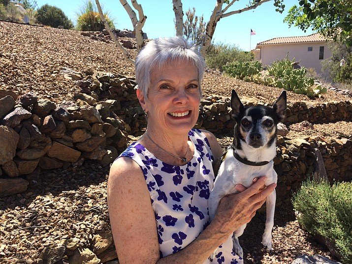 Prescott Unified School District Governing Board member Maureen Erickson poses with her rescue Rat Terrier Rosie in the front yard of her Prescott home. Erickson, a retired educator, is not seeking re-election after six years on the school board; she twice served as board chairman. (Nanci Hutson/Courier)