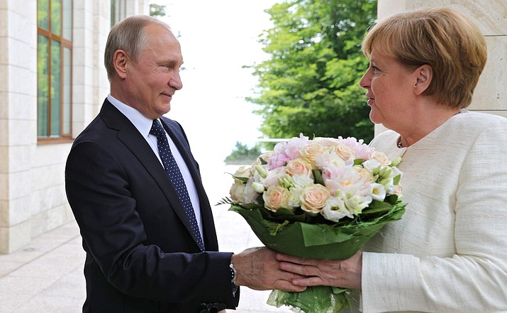 The arrival of the German Federal Chancellor Angela Merkel for talks with Russian President Vladimir Putin in May 2018. Department of Homeland Security said there are no signs of Russia targeting this year's midterm elections. (Photo by Kremlin.ru [CC BY 4.0  (https://creativecommons.org/licenses/by/4.0)], via Wikimedia Commons)